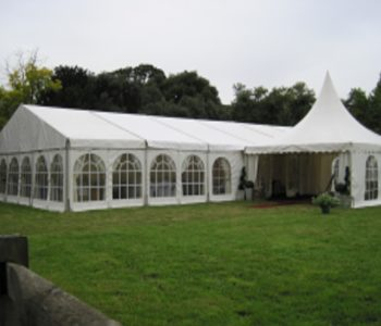 A marquee set up for a wedding in the meadow